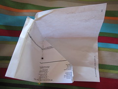 Second - push the fold out. slit the corner.  DO NOT TRIM the mitered part off!