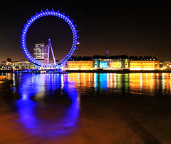 London Eye Reflection (` Toshio ') Tags: life greatbritain blue sea england reflection building london water wheel yellow thames architecture night reflections river circle aquarium colorful europe nightshot unitedkingdom perspective londoneye europeanunion thamesriver toshio sealifelondonaquarium