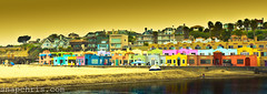 Colorful beach bungalows in Santa Cruz : Venetian Hotel Capitola (tibchris) Tags: california santacruz beach bay monterey colorful colours bright painted capitola skys multicolour cabins beachhouses beachtown colorphotoaward httpwwwcapitolavenetiancom venetianhotelcapitola