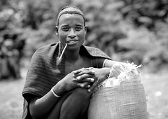 Menit tribe from Tum - Ethiopia (Eric Lafforgue) Tags: africa people blackandwhite haircut man male smile smiling horizontal outside outdoors person noiretblanc market joy pipe omovalley marketplace ethiopia hairstyle tum sourire bonheur personne humanbeing marche joie homme hapiness contemplation coiffure afrique dehors hairdress omo eastafrica abyssinia ethiopie sourir exterieur coupedecheveux lookingatcamera traditionalclothes toum blackandwhitepicture waistup 0981 abyssinie vueexterieure menit afriquedelest traditionalhairstyle alataille etrehumain habittraditionnel photoennoiretblanc meinit valleedelomo regardantlobjectif peoplesoftheomovalley peuplesdelavalleedelomo coiffuretraditionelle cadragealataille habittraditionnels peuplemenit menitpeople tribudesmenits menittribe meinitpeople meinittribe اتیوپی