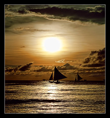 sail away to the land of dreams and imagination... (PNike (Prashanth Naik..back after ages)) Tags: sunset sea orange sun reflection water silhouette clouds island nikon sailing philippines dream boating imagination boracay sailboats sailaway settingsun pnike