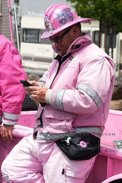 a fireman dressed in pink gear