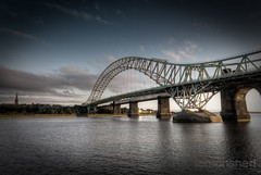 The Bridge with an Edge (lemonshed) Tags: longexposure bridge sea sky test church clouds photoshop canon evening cheshire jubilee sigma 1020mm hdr jubileebridge lightroom runcorn merseyside widnes 2011 rivermersey photomatix weldingglass bridgecrossing