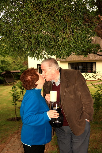 Uncle Will and Aunty Ros under the mistletoe