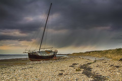 Langstone drifter (Howard Brown) Tags: longexposure seascape storm beach lines rain landscape landscapes boat day yacht dusk hayling south stormy anger beached wreck southcoast leading 1022mm goldenhour langstone leadinglines ultrawideangle angryskies