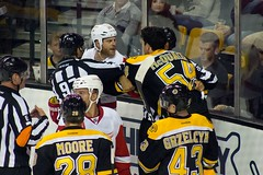 #54 Adam McQuaid and #29 Steve Ott are separated by the officials (Odie M) Tags: nhl hockey icehockey boston tdgarden preseason teamsport sport ice fight tough angry roughing detroitredwings bostonbruins adammcquaid steveott dominicmoore lukeglendening mattgrzelcyk