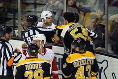 #54 Adam McQuaid and #29 Steve Ott are separated by the officials (Odie M) Tags: nhl hockey icehockey boston tdgarden preseason teamsport sport ice fight tough angry roughing detroitredwings bostonbruins adammcquaid steveott dominicmoore lukeglendening mattgrzelcyk
