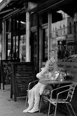 dressed all in white (Paul Steptoe Riley) Tags: street uk england people urban blackandwhite woman streets reflection london english public monochrome female photography cafe boots britain candid headscarf streetphotography documentary blonde british shopwindow aging handbag londonstreet whiteboots blackandwhiteurban paulsteptoerileyportfolio