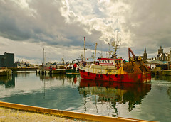 Leaving the Broch (w11buc) Tags: sea scotland boat fishing aberdeenshire harbour contrejour fraserburgh redboat 5photosaday greatscot fraserburghharbour