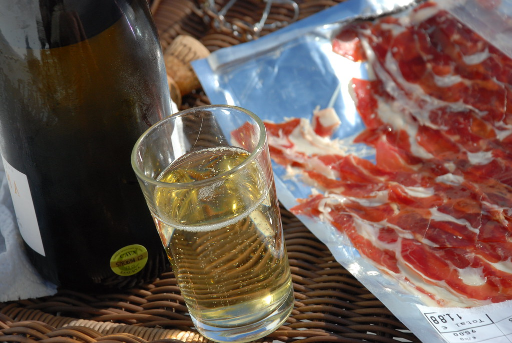 cava and jamon iberico on the porch in barcelona