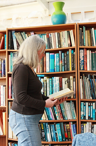 Self-portrait with books by Helen in Wales