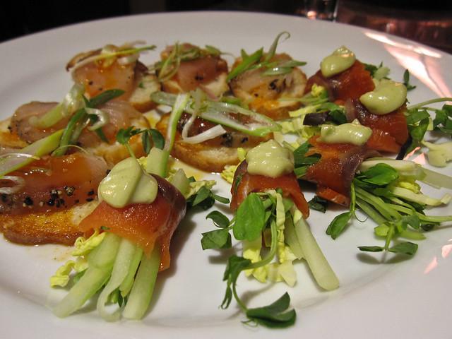 Thinly sliced albacore tuna, warm chili oil and scallion slivers
