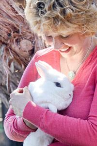 Woman holding a white rabbit