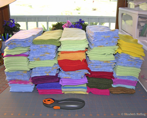 Cutting out piles of fleece for cat toys