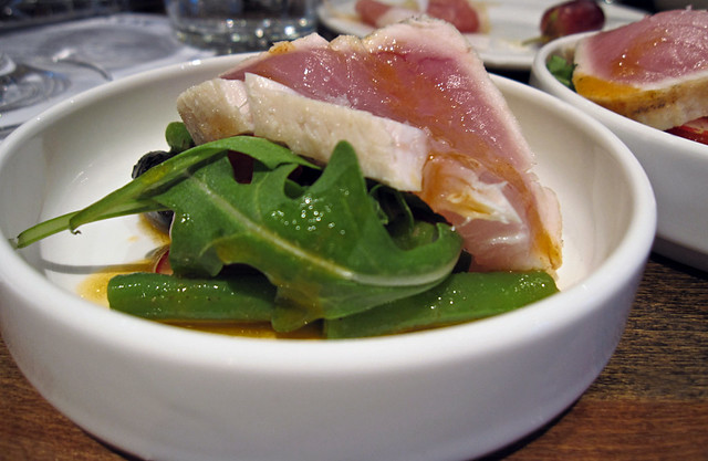 Tuna Niçoise with tomato pulp dressing, greens, olives