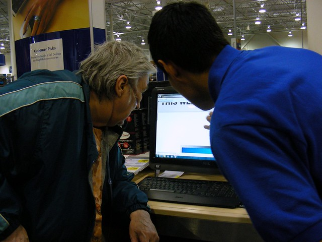 Sly checks out a computer at Best Buy