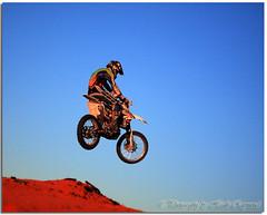 Over & Beyond (Bugalugsrox) Tags: blue red sky bike race jump sand desert spokes wheels helmet australia motorbike outback motor suzuki ochre makita northernterritory finke alicesprings simpsondesert finkedesert