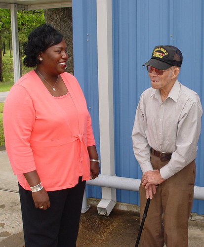 Mississippi Rural Development State Director Trina George listens as a local WWII veteran compliments the agency on its work with the local  water association.