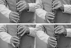 swinging the melody (DianaLisa) Tags: blackandwhite bw musician music canon candid citylife streetphotography jazz clarinet streetmusician fingerdexterity musicalchops