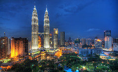 Flying Through the Night Skies of Kuala Lumpur (Stuck in Customs) Tags: travel sky architecture night digital photography flying blog high asia southeastasia skies cityscape dynamic stuck south capital towers east photoblog software malaysia processing imaging greater kualalumpur 2008 range kl hdr tutorial trey klang travelblog customs ratcliff klangvalley hdrtutorial stuckincustoms nikond2xs treyratcliff photographyblog stuckincustomscom lembahklang  modernlightsmarch
