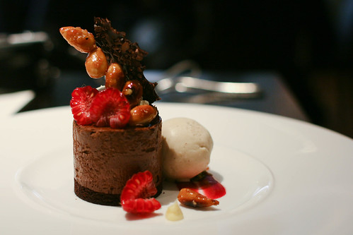 Valrhona dark chocolate delice with raspberries and almonds