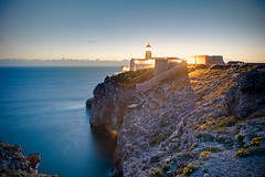 Twilight at Cape St. Vincent (Allard One) Tags: longexposure lighthouse portugal architecture spring twilight nikon rocks dusk landmark structure cliffs le april bluehour 24mm algarve pt atlanticocean vuurtoren iso1600 gettyimages marinelife crepsculo sagres rotsen 2011 capestvincent costavicentina cabodesovicente crepusculum d700 nikond700 theendofeurope nikkor2470mmf28 horriblelightingconditions gustingwinds allardone vincentinecoast allard1 blueisgoodforyou southwesternmostpointofeurope europestopshere zuidwestelijkstepuntvaneuropa guardingoneoftheworldsbusiestshippinglanes allardschagercom