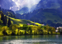 Painted with light (ceca67) Tags: blue trees houses light mountain lake alps art nature landscape switzerland photo nikon image artistic swiss fineart mount fields dreamy rays ceca