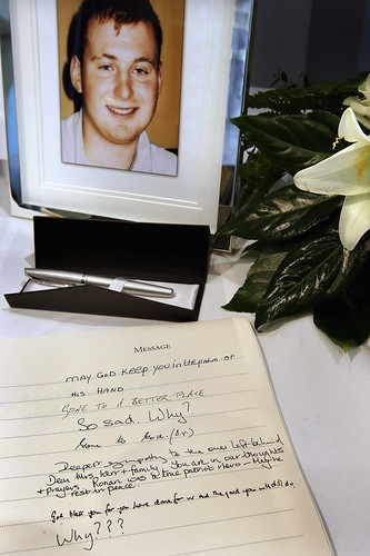 Members of the Public Write in a Book of Condolence for Police Constable Ronan Kerr