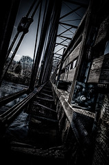 Under the bridge (Sean Kanada) Tags: railroad bridge urban texture lines dark raw moody darkness yo sean best line dope grime chill vector hdr kanada darknessfalls 2011 eauclair linecomposition ilovehdr urbanhdr thegrime hdrtracks darkhdr texturehdr vectorline 2011hdr grimehdr falls2011 dopepicture
