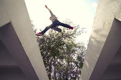 Leap (Brandon Kuzma) Tags: roof light sky jump gap skateboard rays