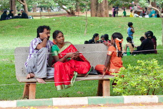 Family on a bench in Cubbon Park in Bangalore