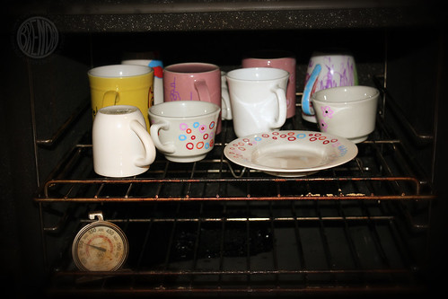 baking mugs and plate in oven