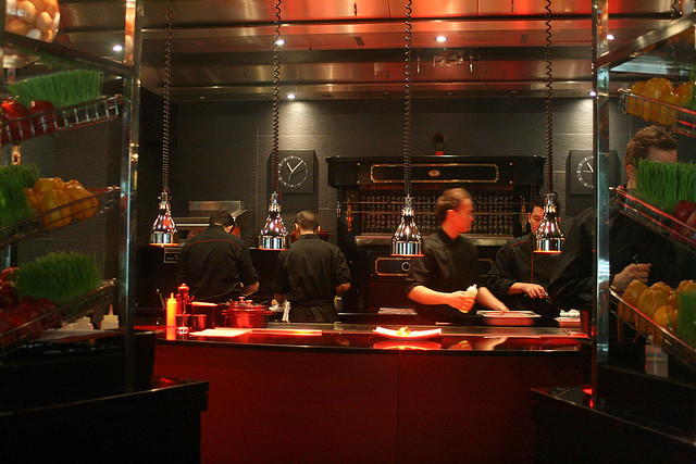 L'Atelier de Joël Robuchon features an open kitchen where you can watch chefs prepare your meal right before your eyes