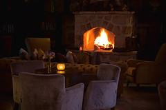 By the fire (Melissa Maples) Tags: brown caf bar turkey dark fire restaurant nikon fireplace asia lounge trkiye sofa antalya nikkor vr afs  18200mm   f3556g d40  18200mmf3556g vanillalounge