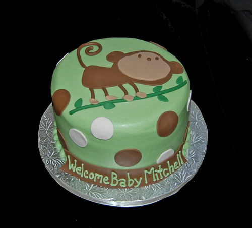 sage green and brown monkey baby shower cake