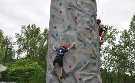 Kids Climbing Wall as part of National Get Outdoors (GO) Day in Denver's City Park.  Thousands of kids and families attended Denver's GO Day event enjoying a range of outdoor activities like rock climbing, mountain biking, fishing, canoeing and more.