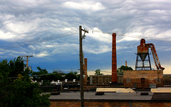 turbulent sky (kkurtz) Tags: city summer sky chicago architecture clouds illinois backyard rust industrial cityscape watertower logansquare chicagoist