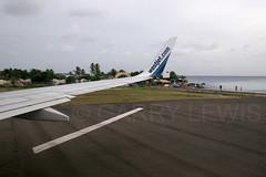 Westjet Boeing 737-700 C-FIWS (atcogl - ATC @ YYZ) Tags: beach plane airplane aircraft wing jet caribbean boeing westjet stmaarten runway maho sxm airliner 737 sunsetbar b737 boeing737 tncm mahobeach 737700 wingview cfiws wja