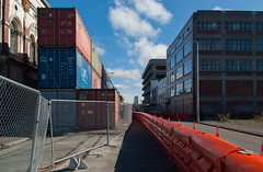 Follow the Orange Line (Jocey K) Tags: road newzealand christchurch sky signs architecture clouds fence buildings shadows demolition cbd shippingcontainers roadcones earthquakedamage formercivicbuildingdemolition millersdepartmentstoredemolitionstreet