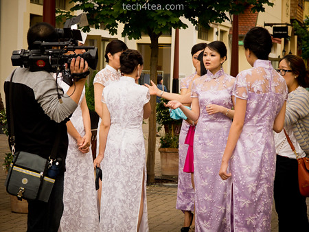A group of chinese ladies were filming some variety cum hosting programme at the shopping outlet.