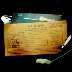 04:23:2012 (MilkaWay) Tags: orange car warning georgia ticket athens johns 2012 day114 parkingviolation immobilized theboot 366 clarkecounty hipstamatic iphonograpy iphone4s canocafenol