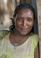 Tattooed Forehead Woman With A Christian Cross Pendant Ethiopia (Eric Lafforgue) Tags: africa portrait people haircut cute beautiful beauty smile smiling vertical pretty picture tribal photograph blackpeople omovalley ethiopia tribe bodyart hairstyle pendant frontview colorphoto nomadic youngwomen nicelooking onepersononly humanface onewomanonly lookingatcamera 7676 christiancross womenwoman indigenousculture southernethiopia tattooedface truepeople 3539years exterioroutdoors omotic 4044years blackethnicity ethiopianomovalley abyssiniahornofafrica beautifulbeautycuteprettynicelooking ethio7676