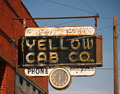 TAXI STAND (FotoEdge) Tags: red orange clock colors sign yellow ancient flickr downtown neon glow time cab taxi memories rusty stjoseph headlights mo missouri handpainted co hanging wired neonsign autos burst yellows hacks crusty explode serenade drivers saintjoseph relic roadway remnant taxistand stjoe dispatcher cabstand fotoedge bobtravaglione midwesternserenade