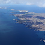 Island of Coll with Tiree in the distance