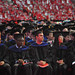Masters and doctoral candidates listen to the commencement address in PNC Arena.