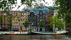 Amsterdam (SK snapshots) Tags: houses holland netherlands amsterdam architecture boot boat canal houseboat boote boten canals architektur nl huis schiff schiffe architectuur amstel niederlande gracht huizen häuser hausboot möve woonboot gondeln dutsch laars sksnapshots