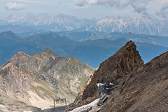 Top Kitzsteinhorn Cable Car Station (Roger Hanuk) Tags: alpine austria flag furnicular kaprun kitzsteinhorn mountainrange object railway train salzburg at