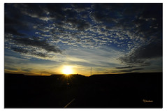 On the road through an African Sunset (G.hostbuster (Gigi)) Tags: africa light sunset sky clouds dark evening tramonto nuvole driving cielo marocco luce sera buio ghostbuster guidando sullastrada gigi49 ontheroad