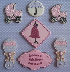 close-up of baby shower cookies (Songbird Sweets) Tags: umbrella 100v10f babyshower sugarcookies babycarriage rattles