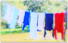 Blowing in the wind (Kerkira) Tags: colours digitalart laundry clothesline dailylife ropa washingline vividimagination blowinginthewind flickraward sharingart awardtree mygearandme netartii